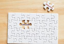 Compliance, Regulation words written on white jigsaw puzzle,business concept background