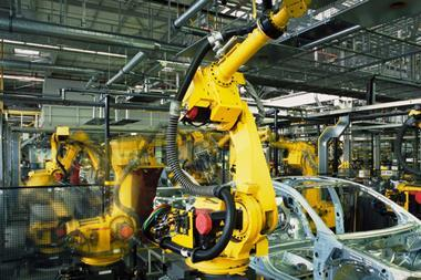 manufacturing-yellow-robots-welding-cars-in-a-production-line