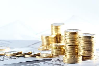 Coins on financial report