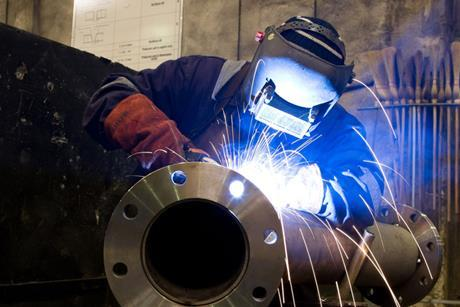 worker-with-protective-mask-welding-metal-and-sparks