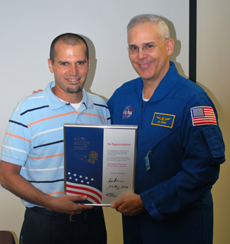 Vitor recieving Silver Snoopy Award from NASA Astronaut, Lee Morrin