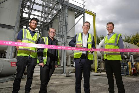 A-Gas Group Chief Executive Andrew Ambrose officially cuts the ribbon to open the new separator. Watching is A-Gas Managing Director John Ormerod and fellow A-Gas employees Jimmy Holmes and Paul Sunshine.