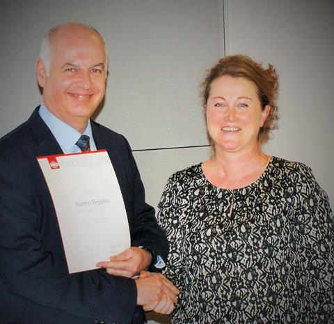 Dr Warren Hepples, who has been appointed as the new Chair of the ISO/TC 58 committee, receives a Certificate of Appreciation from Mme Blandine Garcia, of the ISO Central Secretariat, for his contribution to standards.