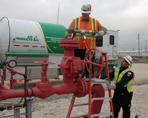Air Products Express Services' technician connects nitrogen line from mobile nitrogen pumper to customer's pipeline.