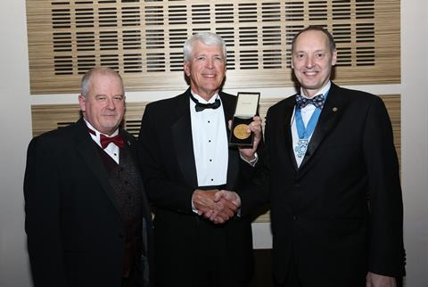 Mr Watson receiving the J & E Hall Gold Medal from IOR President Steve Gill. (L) J & E Hall Managing Director Mark Roberts.