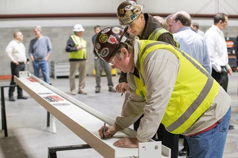 representatives from Lincoln Electric and other companies working on the project participated in a beam-signing ceremony. On-hand to sign the beam were Chris Mapes, George Blankenship and Doug Lance from Lincoln Electric's senior management.