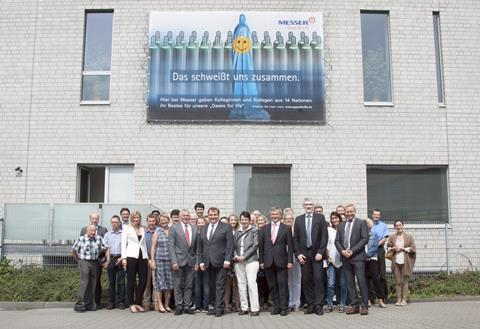 Mayor of Krefeld (front row, second from the left) visists Messer