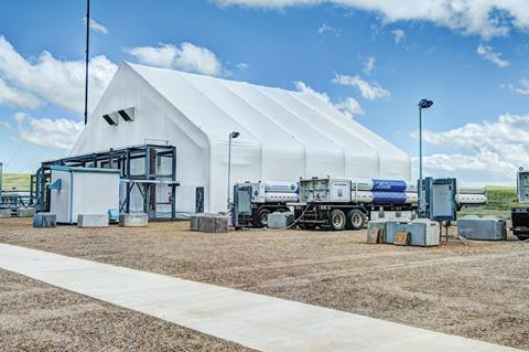 He picture shows the linde engineered helium purification facility in mankota, canada, together with helium tube trailers (right) for customer deliveries